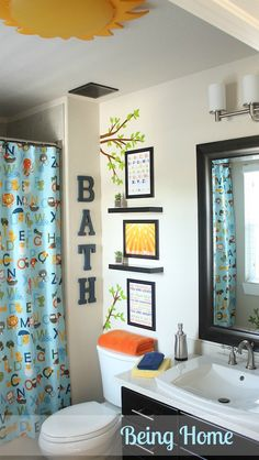 Boys bathroom :  Love the letters. Maybe BATH over tub and WASH over the sink. Ha FLUSH over the toilet!