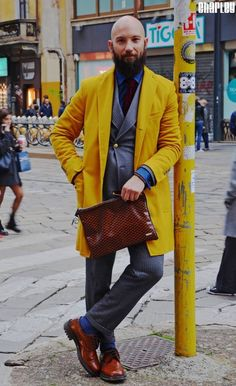 pittiuomo86:  A 10. This cat is killin em. The juxtaposition of the unkempt alpha male beard against the canary yellow car coat is compelling. A great example!