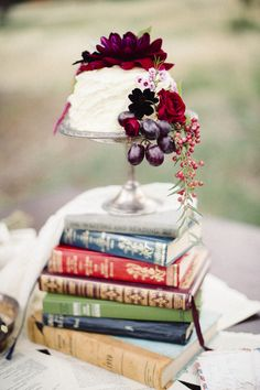 Stack of books cake stand | Bellamint Photography and Sunflower Creative | see more on: http://burnettsboards.com/2014/09/literary-wedding-book-page-wedding-dress/