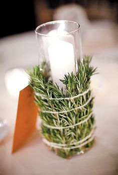 Candles with rosemary accents. Abby Rose Photo.