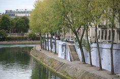 Ruas calmas e belas fachadas residenciais da Île Saint-Louis.