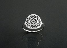Handmade Sterling Silver thin Filigree Ring with a Beautiful Flower of Life Design. It has a Light Oxidized Finish and its Coated with Sterling Silver. Ring diameter : 1.4 cm Average silver weight: 1.2 gr. You may also like : - The Mandala Sacred Ring