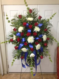 Funeral Spray using Bells of Ireland, White Fuji Mums, and Red Roses accented with Royal Blue Ribbons. Casket Flowers, Grave Flowers, Cemetery Flowers, Funeral Flowers, Wedding Flowers, Funeral Floral Arrangements, Rose Arrangements, Floral Design Classes, Funeral Sprays