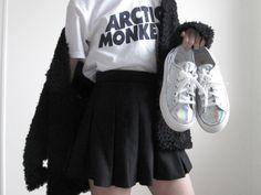 band tee + black skirt + silver platforms + black fur jacket