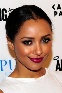 Simple, slicked back hair is the best way to show off a major makeup look—like perfect-for-fall gold-dusted skin and dark berry lips, à la Vampire Diaries' star Kat Graham.   - Cosmopolitan.com