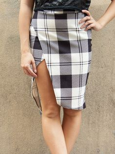 Go school-girl chic in this vintage-inspired plaid pencil skirt with its edgy modern side slit. For a fresh take on a workweek classic, just pair this smart knee-length skirt with a bright blouse and the black and white plaid print really pops! Hand wash. Imported.