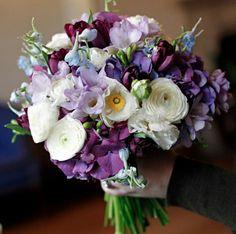 Wedding Bouquet Arranged With: Blue/Purple Hydrangea, Merlot Tulips, Blue Delphinium, Lavender Freesia, White Ranunculus & White Poppies