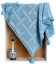 On a wonderful and cool night or day, feel warmth and love when you wrap your special little boy in this stylish Dream Catcher Blanket! Give your boy a soft snuggly hug with this very first piece from the boy's collection. As he falls into a gentle slumber, may his bad dreams get tangled in the blanket's intricate basket-weave design, and his good dreams softly slip through. While promising a peaceful bedtime, this blanket's versatility allows it to make a stylish, fashion-forward addition…