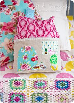 Take a plain boring pillow and sew on felt things that go with your room.  Easy and decorative!