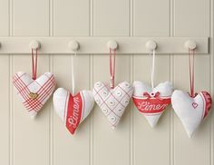 These adorable heart hangers are quite easy to make and a set will be a fabulous gift. You will need: Tea towels –linen & cotton Narrow ribbons – try satin & gingham Buttons & beads Red stranded cotton Toy stuffing…