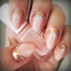 I love the shape of the nails, they aren't the stereotypical square tips plus they compliment the shape of her fingers nicely. The color is rich, calm and smooth and the glitter gives it a beautiful glitzy look.