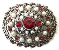 This is a lovely pin large about 3 inches by 2-1/4 inches & about 1 inch or more in depth. Very nice condition....  #pearl #red #ruby #silver #vintage #jewelry