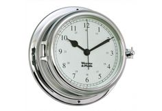 Generous size, easy-to-read dial Accurate quartz clock movement Maintenance-free brass finish Beveled glass crystal Traditional porthole front opening bezel Mounting methods for boat or shore Wood . Weather Instruments, Desktop Clock, Tabletop Clocks, Nautical Gifts, Clock Movements, Beveled Glass, A Table, Chrome, Quartz
