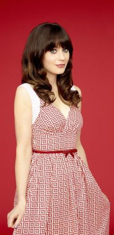 Zooey Deschanel. Because she's gorgeous and I want to be her best friend.