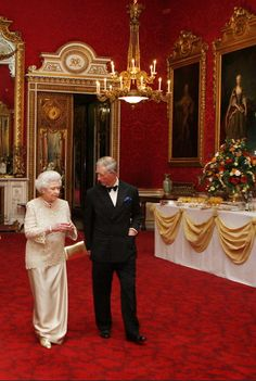 Queen Elizabeth II and Prince Charles in the State Dining Room, Buckingham Palace.