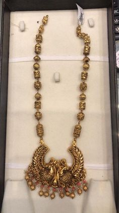 22 carat gold nakshi balls and square shaped long chain with dual peacock embossed half moon designed pendant. Real Gold Jewelry, Gold Jewelry Simple, Gold Jewellery, Latest Jewellery, Indian Wedding Jewelry, Indian Jewelry, Bridal Earrings, Bridal Jewelry, Silver Ring Designs