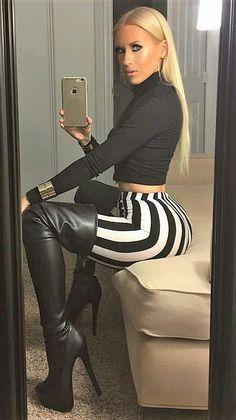 Blonde selfie in thigh boots