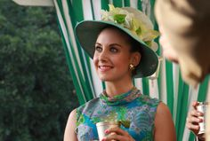 Trudy is positively elegant in this floral hat and brilliant blue print, episode 303