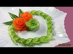 Fruit & vegetable art & design are very interested! We'll think of carrot rose flower which is one of the most popular ornaments in fruit & vegetable carving and cutting. In this video, we make cucumber L'art Du Fruit, Deco Fruit, Fruit Art, Fruit Cakes, Radish Roses, Cucumber Flower, Carrot Flowers, Rose Flowers, Food Art