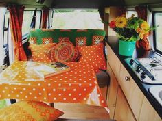 groovy orange interior volkswagon campervan. and he thought to camper was safe... i think not