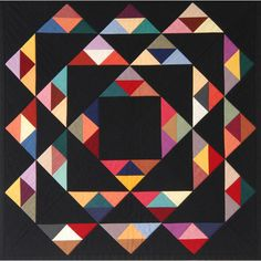 Amish Triangles by Julia Oakshott.Uses all 27 Colourshott colours COTT01-27.