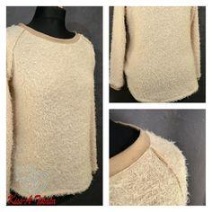 Raglan-Pullover aus Strickstoff und beschichteten Jersey.