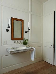 elegant bathroom design with marble vanity, marble sink and sconces in traditional bathroom design with wainscotting, elegant powder room decor, Pimlico House Luxury Interior Design, Bathroom Interior Design, Floating Sink, Rose Uniacke, London Townhouse, Wall Mounted Sink, Wall Sconces, Mirrors, Tadelakt