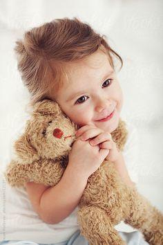 Little girl with toy by Dejan Ristovski