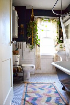 bathroom inspiration - plant filled with black walls and lots of white