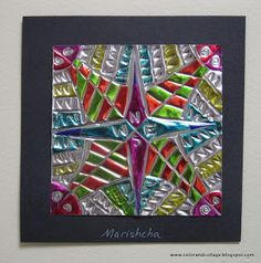 from Color, collage, and much more blog: compass rose designs on metal