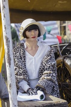 I love that coat and hat!  Miss Phryne Fisher (Essie Davis) in 'Blood At The Wheel' (Series 2, Episode 7)