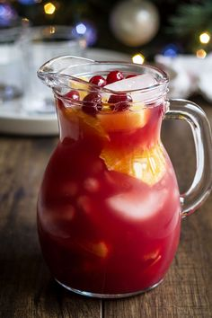 Cranberry Pineapple Sangria - The perfect special drink for your holiday plans. : Cranberry Pineapple Sangria - The perfect special drink for your holiday plans. Sangria Recipes, Punch Recipes, Cocktail Recipes, Drink Recipes, Margarita Recipes, Christmas Drinks, Holiday Drinks, Holiday Sangria, Thanksgiving Cocktails