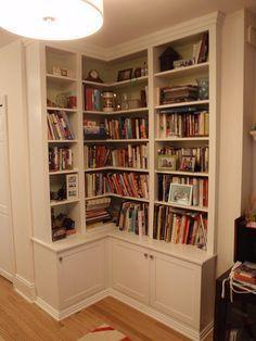 Corner bookshelves for living room with enclosed bottom.