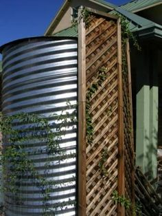 Corrugated above ground cistern + plantings around base to cool tank