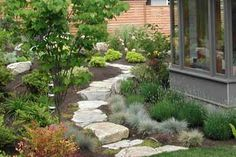 Granite path from lawn to perennial garden - Kenneth Philp Landscape Architects -
