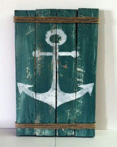 4 planks from a pallett. Paint your desired color then, Hot glue strands of rope at both ends and then stencil on your favorite graphic.