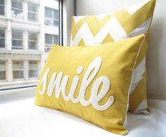 Perfect for on a gray day - like today! http://www.etsy.com/listing/62224385/smile-pillow-in-yellow $38 USD