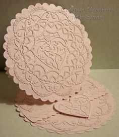 I have created a shaped easel card.  I quite often get emails from our viewers asking how to make a shaped card and keep the die shape. #cheeryld #shulsart Dies used: XM Scalloped Oval - XM-8; Square - Scalloped LG Stackers Nesting Dies - XL-2; Circle - Scalloped LG Stackers Nesting Dies - XL-5; Circle Classic - LG Silver Stackers - L-4; Oval Classic - SM Silver Stacker Layers - M-7; Petite Hearts Embossing Plates - E136; Sophia's Heart - DL184; (Continued)…