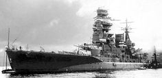 """Japanese battleship """"Mutsu"""" (Nagato-class) during her preparatory work in the naval base at Yokosuka. Sailors are busy checking the ship's systems and working on her body. She met her untimely end not through hostile fire, but by internal explosion in the summer of 1943.  On the right side of the photo a float-scout Nakajima E8N1 is visible being loaded, as it was the basic IJN reconnaissance aircraft of the Second Sino-Japanese War"""