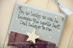 Handmade plaque decorated with a peg and distressed wooden star and finished with blue gingham ribbon. Sign reads ' I'm as lucky as can be because the world's best Dad belongs to me' from www.daisychainhomeandgifts.co.uk