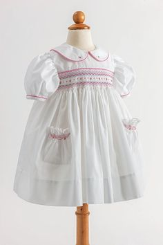 Vintage Inspired Girls Dress: Pockets and Posies - Classic Sewing. I wish I had better sewing skills! Vintage Baby Dresses, Smocked Baby Dresses, Baby Girl Dresses, Peasant Dresses, Dress Girl, Baby Frock Pattern, Frock Patterns, Baby Clothes Patterns, Smocking Patterns
