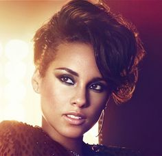 This girl is on fire is one way to put it when it comes to the beautiful singer Alicia Keys with her gorgeous short updo leaving her fringe a little messy yet still looking as elegant as she always does.