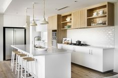 Overheads and pantry in Natural Oak Ravine. A sleek white and timber colour scheme