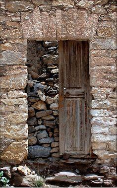 Love this one,  Real de Catorce. México. By Juan Garza Lozano ~ The door is simply decor.