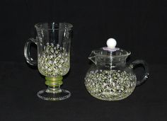 The Field Flower Collection at www.TheColorfulWife.com!  Hand painted dinner and glassware that is made in Michigan.