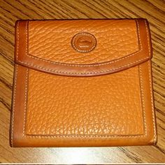 Authentic vintage Dooney & Bourke bifold wallet Authentic vintage Dooney and Bourke all weather beveled leather bifold wallet used in good condition as seen on pictures water stain on back of wallet where change purse is does not effect the look of wallet price is  firm. Dooney & Bourke Bags Wallets
