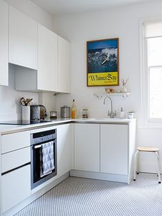 London home of Susie Clegg - In a small kitchen, white walls and simple, handle-free, matt white units give a sleek, neat look. I couldn't resist Corian worktops, which although expensive, look stunning and lift the rest of the room. The hexagonal floor tiles were inspired by some we saw on a visit to Los Angeles.' →