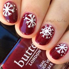23 Latest Winter-Inspired Nail Art Ideas: #1. DARK RED NAILS WITH WHITE SNOWFLAKES; #nailart