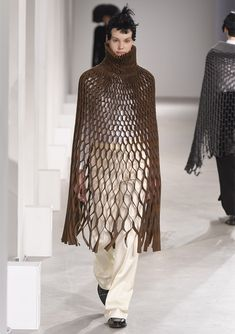 Junya Watanabe folds textiles into mathematical patterns for Autumn Winter 2015.