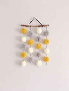 A sweet handmade Pom Pom hanging. Made to order and available in a variety of colours and styles. Pom Poms are hung with 4Ply bakers yarn and attached to a piece of treated driftwood. The driftwood measures between 6-7 inches but please bare in mind the driftwood comes in